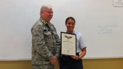 Cadet Spezia recieving her Billy Mitchell award with Group 221 Commander Major Isom